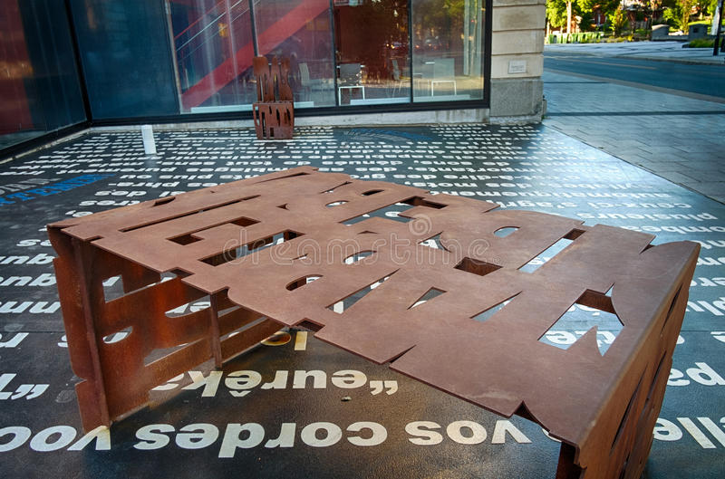 Metal Font Rusted Table. 1977 NCT becomes owner of Granada renovating it to accommodate 850 theater goers. The Granada was renamed Théâtre Denise-Pelletier royalty free stock photos