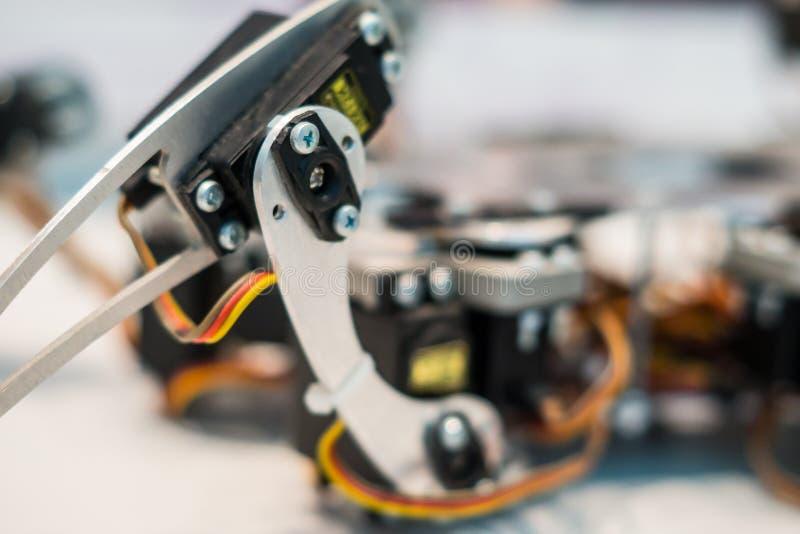 Metal foot of spider robot stock photos