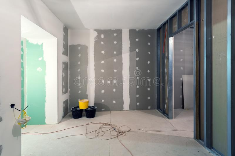 Download Metal Frames And Plasterboard Drywall For Gypsum Walls, Three Buckets And Electric Wires In Apartment Is Under Construction Stock Image - Image of cable, wires: 110699133