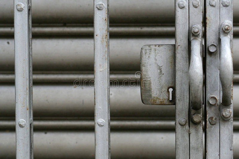 Metal gate. With key hole royalty free stock photos
