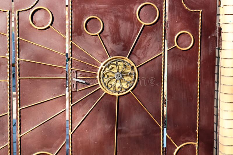 Metal gates with forged elements. Closen stock image