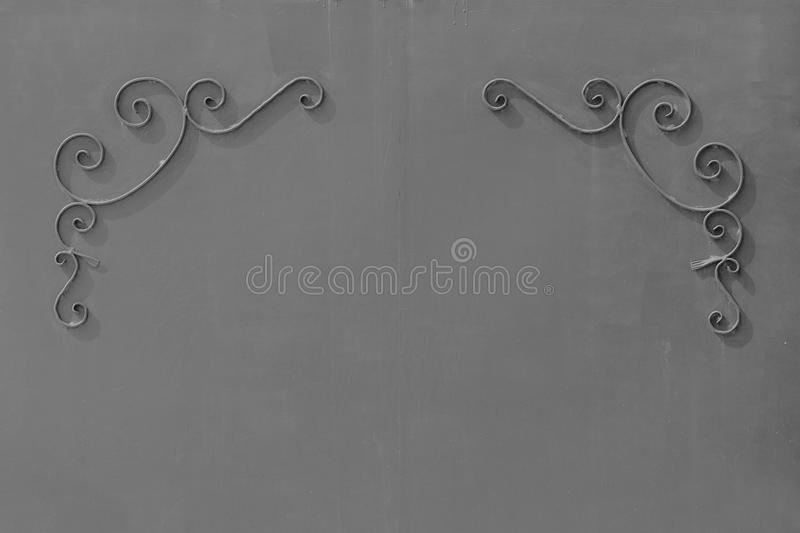metal gates with a pattern in the form of curls covered paint. stock image