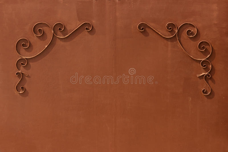 metal gates with a pattern in the form of curls covered paint. royalty free stock images