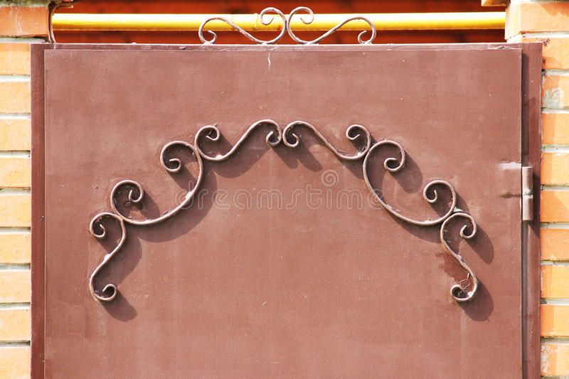 metal gates with a pattern in the form of curls covered paint. royalty free stock photo