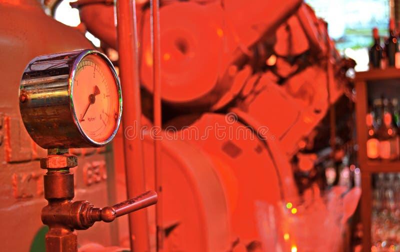 Metal gauge in red illuminated technical room - Wasserwerk Berlin royalty free stock image