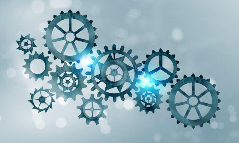 Metal gears and cogwheels stock images