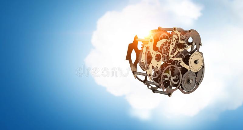 Metal gears connected. Mixed media. Gears and cogwheels mechanism floating in air. Mixed media stock image