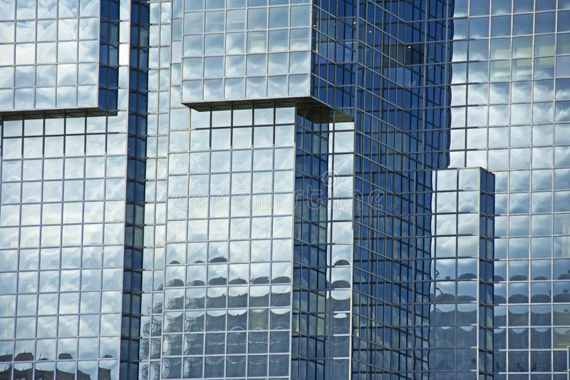Metal & Glass Fronted Building. A blue metal and glass clad fronted building from the financial district in London, England stock image