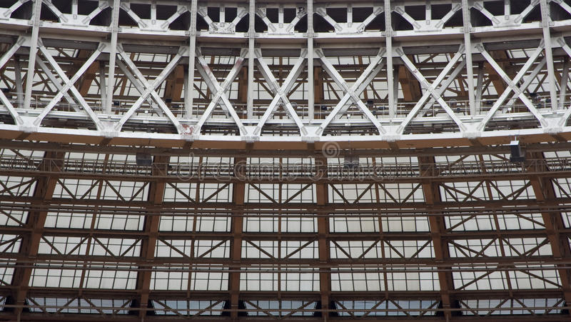 Metal and glass intersecting structure. On the upper part of the stadium royalty free stock photos
