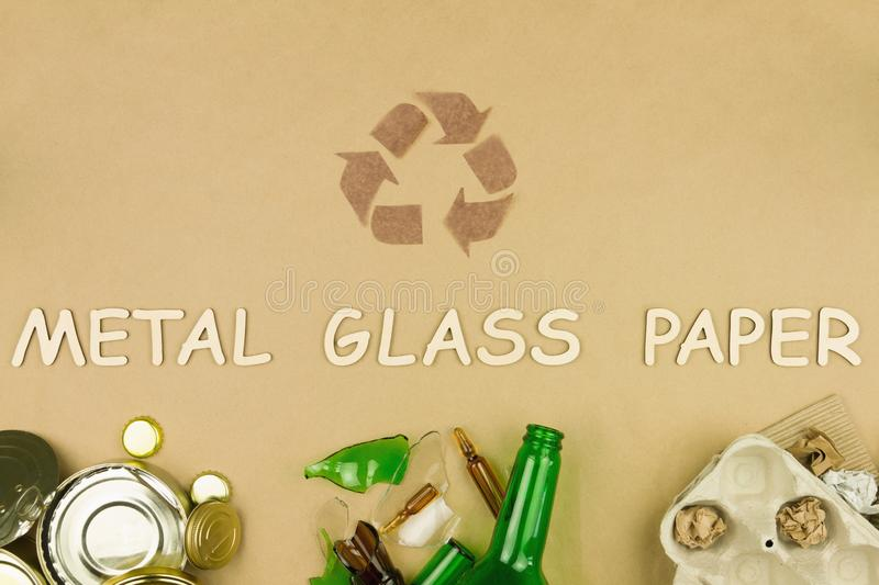 Metal glass paper recycle concept. Enviromental issue, ecology care, recycling concepts. Metal glass paper recycle concept, Brown recylce symbol sign with metal royalty free stock images