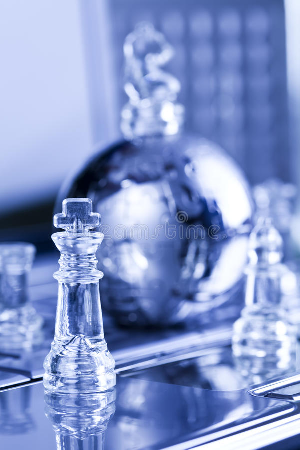 Metal globe and chess. Notebook & puzzle earth chrome globe royalty free stock photos