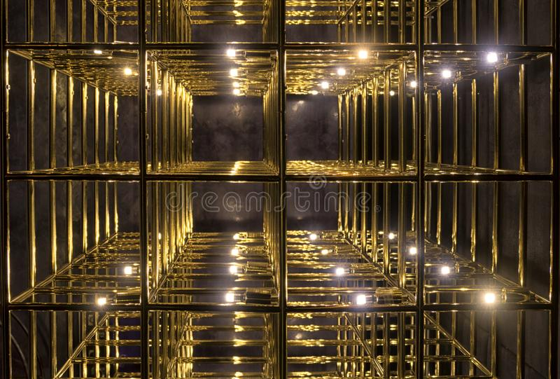 Gold grid on a black background. Metal gold grille on a black background royalty free stock photography