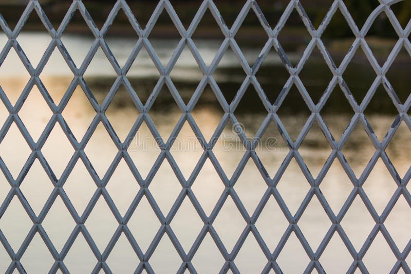 Metal grate pattern. Metal grate pattern river background stock images