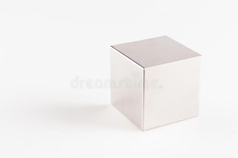 Metal grey cube on a white background stock photos
