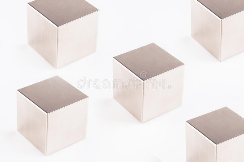 Metal grey cubes on a white background. Abstract geometric shape royalty free stock image