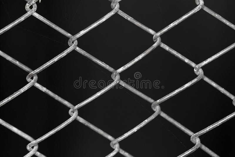 Metal grid on a black background background.  royalty free stock photo