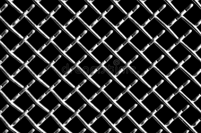 Metal grid on black background stock photography
