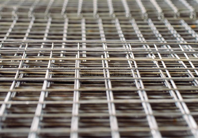 Metal grid. Heavy industry production. Metal rolling plant. stock images
