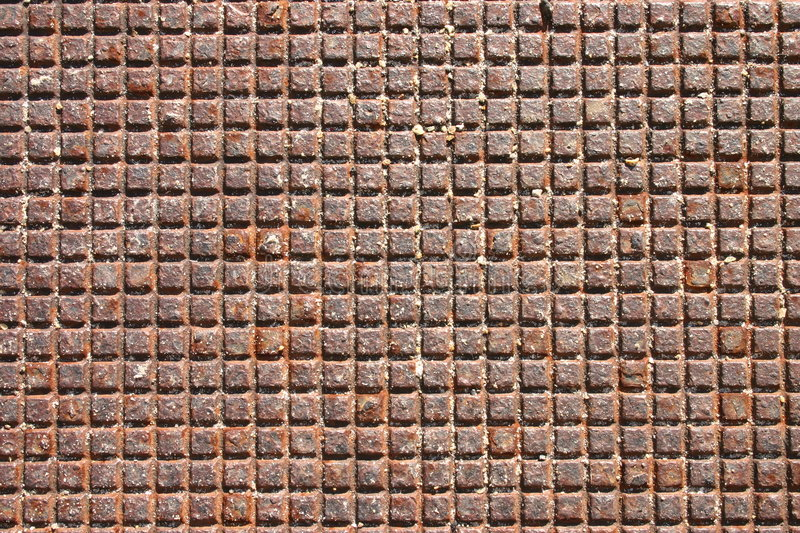 Metal grid from a manhole cover stock images