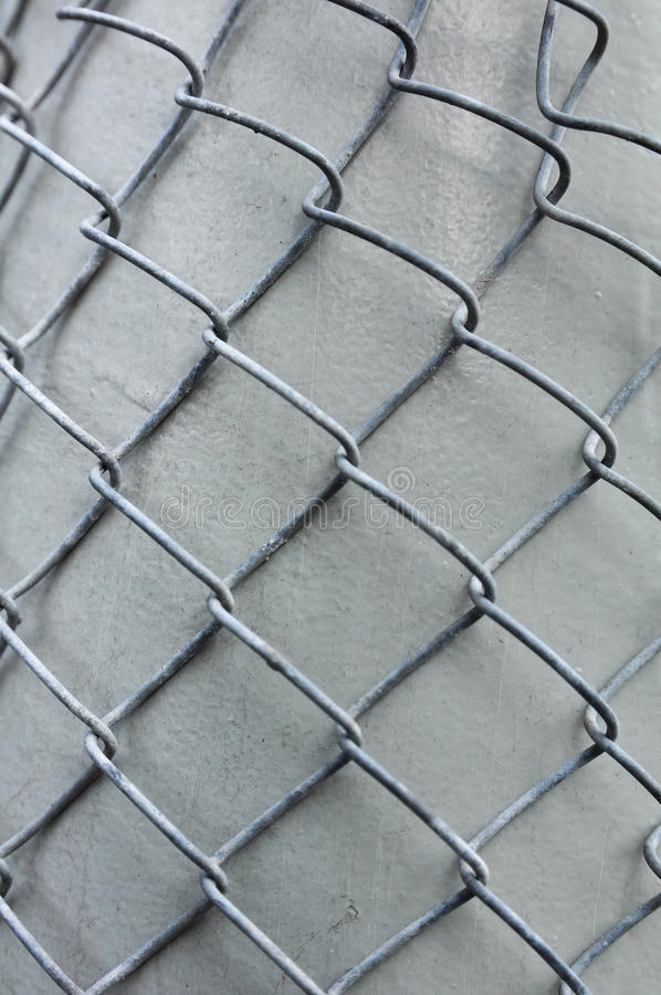Download Metal Grid Overlaid To Gray Column Royalty Free Stock Images - Image: 26242519