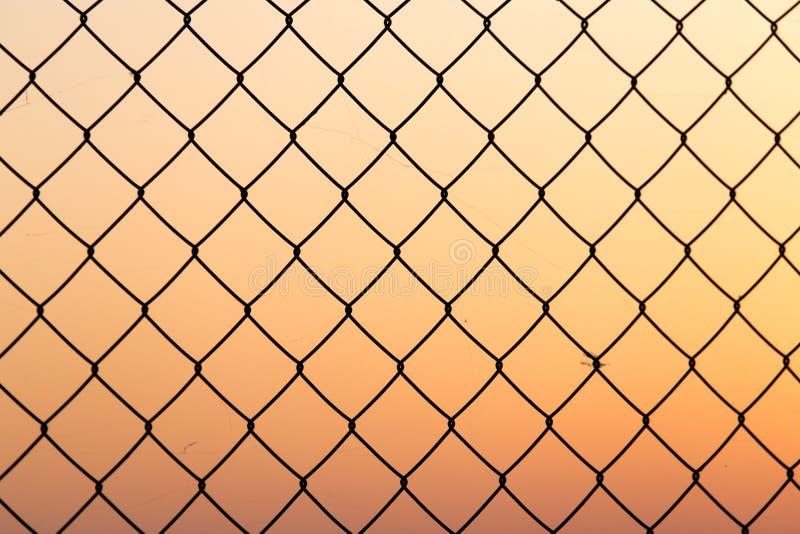 Metal grid at sunset stock photos
