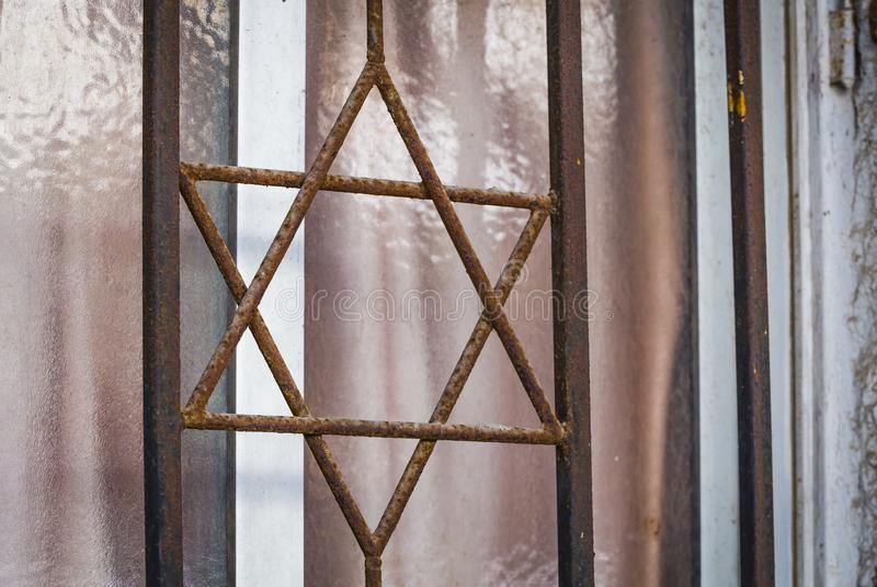 Metal grille in the form of six pointed star of David closeup in Netanya, Israel royalty free stock images