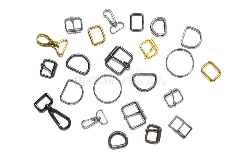 Metal half rings, buckles and carbines on a white background. View from above. Metal half rings, buckles and carbines on a white background royalty free stock photography