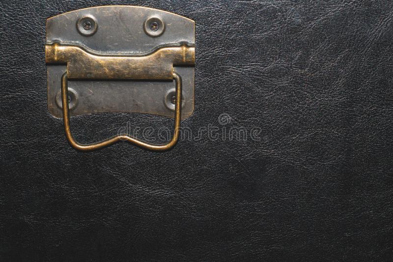 Metal handle with black leather background. copy space. Metal handle with black leather background stock images