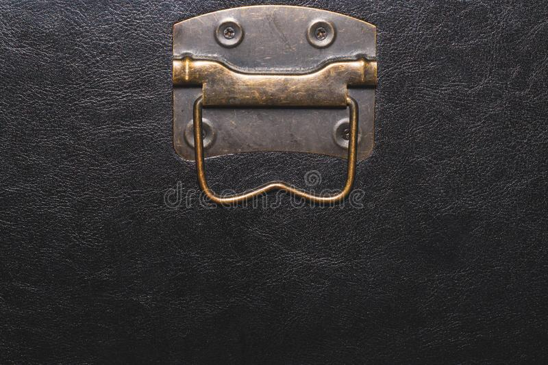 Metal handle with black leather background. copy space. Metal handle with black leather background stock photos