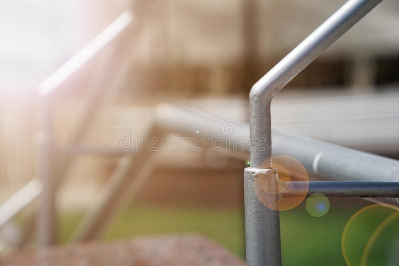 Metal handrails on crossing the road, close-up, shadows. Sun beam lights.  royalty free stock photography