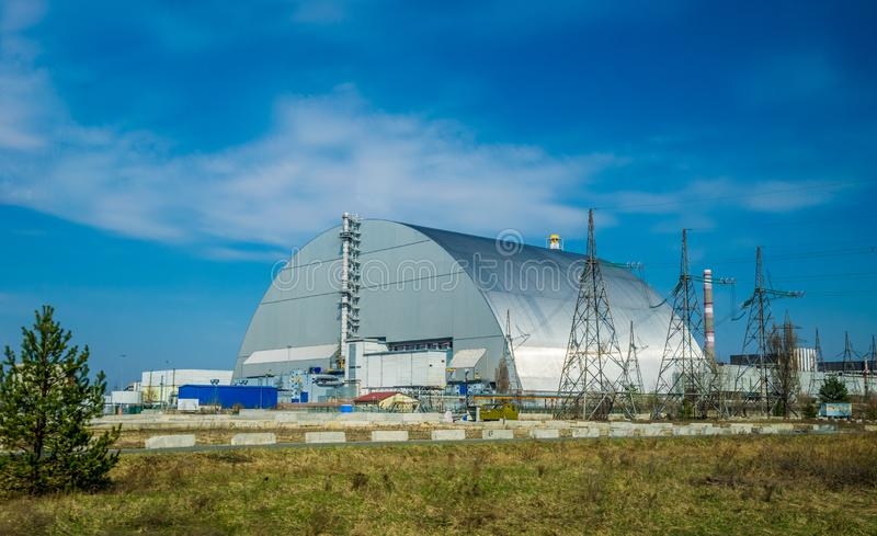 Production facilities of the Chernobyl nuclear power plant, Ukraine. Fourth emergency power unit and exclusion zone. Metal hangar protective shelter on the stock images