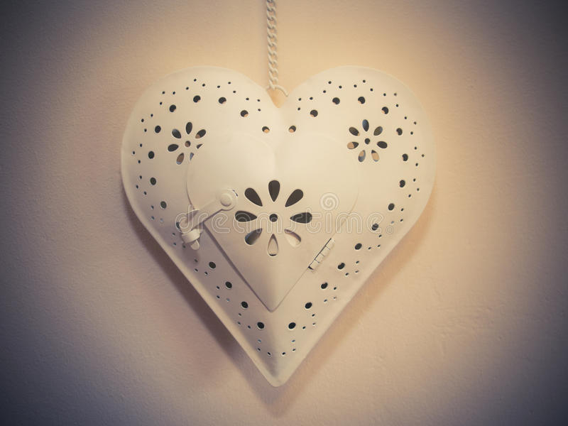Metal heart hanging by chain royalty free stock photo