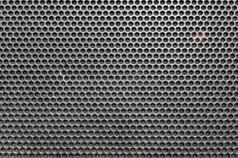 Metal honeycomb grilled pattern in front of music speaker as background vector illustration
