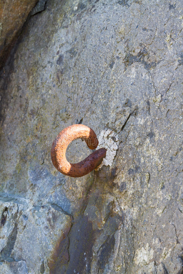 Metal hook set in rock. World War Two Roadblock. Almost certainly part of a WWII roadblock, hook to stretch cable across road. Nant Francon Pass, Gwynedd, Wales royalty free stock photos