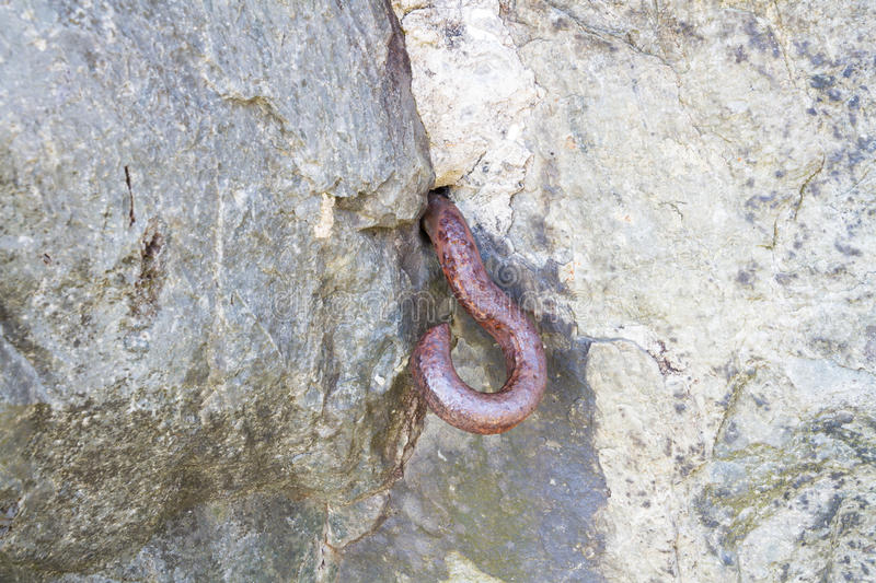 Metal hook set in rock. World War Two Roadblock. Almost certainly part of a WWII roadblock, hook to stretch cable across road. Nant Francon Pass, Gwynedd, Wales stock photo