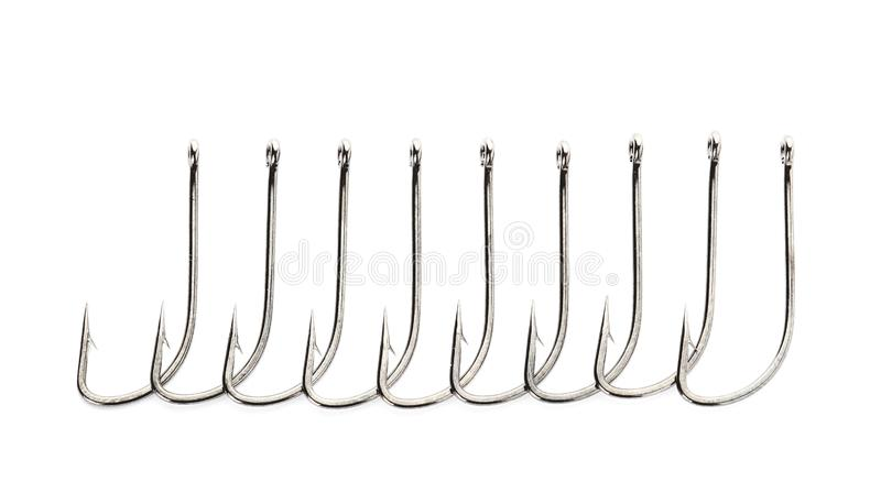 Metal hooks on white background. Fishing accessories royalty free stock images