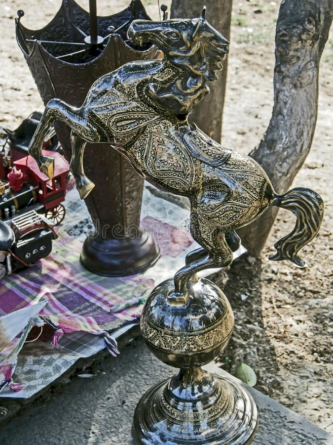 Metal horse figurine is sold at the flea market. In Tbilisi royalty free stock photography