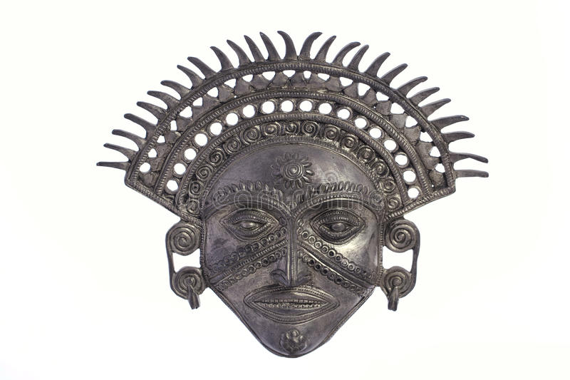 Metal Inca Sun God Mask. Ornate metal Inca Sun God mask isolated against white background royalty free stock images