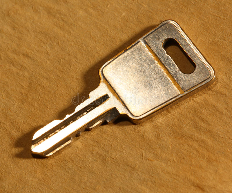 Metal key on paper royalty free stock images
