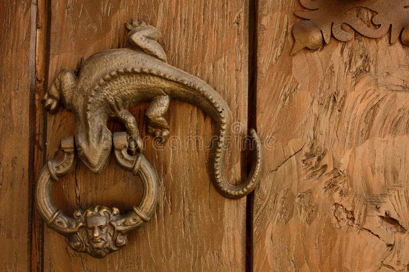 Metal knocker shaped dragon, lizard. royalty free stock images