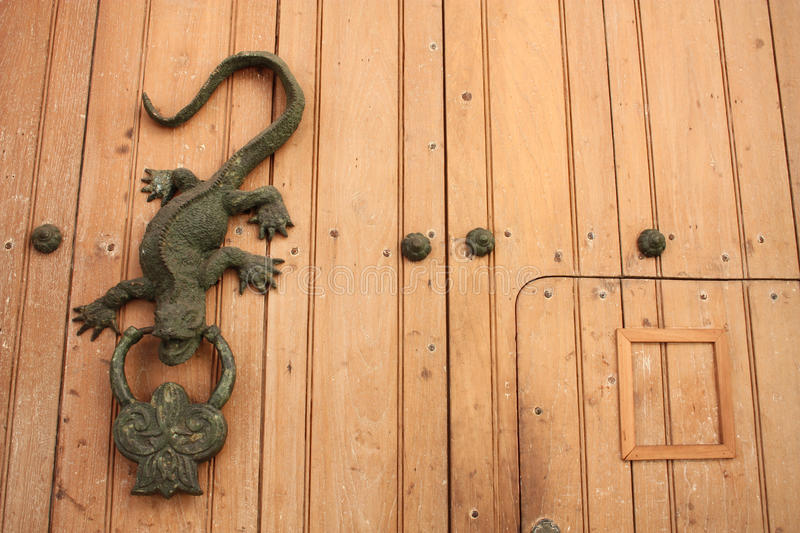 Metal knocker shaped dragon or lizard royalty free stock images