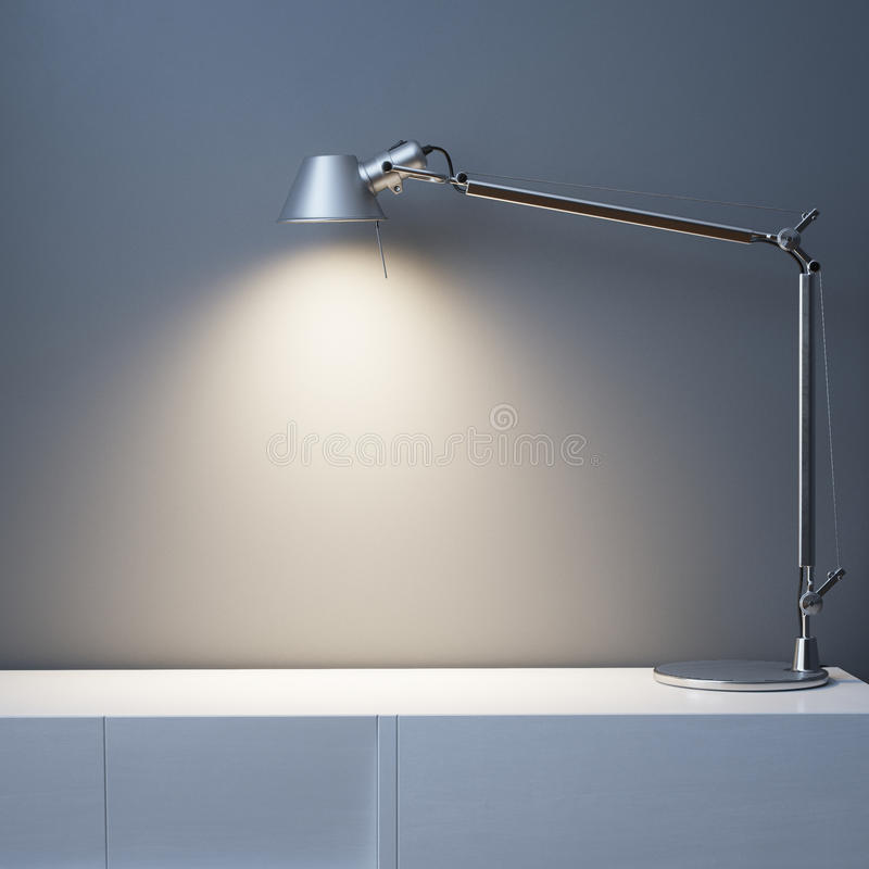 Metal Lamp On The White Desk In Black Wall Interior Room royalty free stock photos