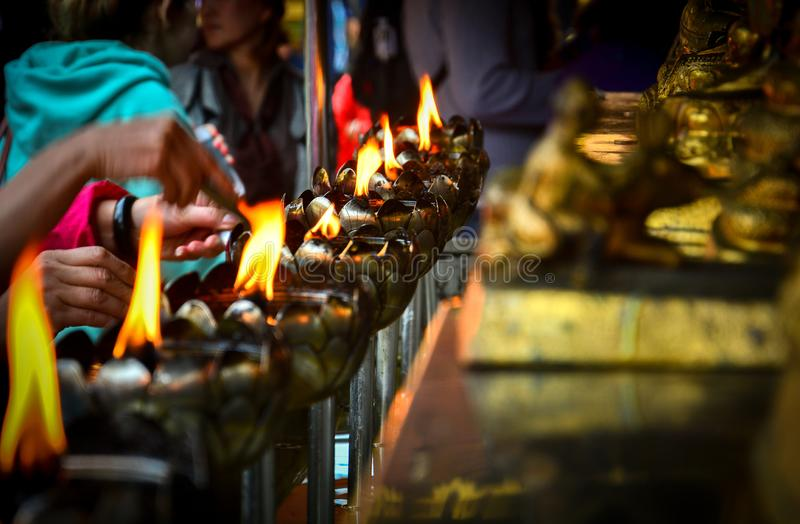 Metal lantern in lotus shape with candle and oil for worship the Buddha in Buddhist temple Wat Phra That Doi Suthep, Chiang Mai stock image