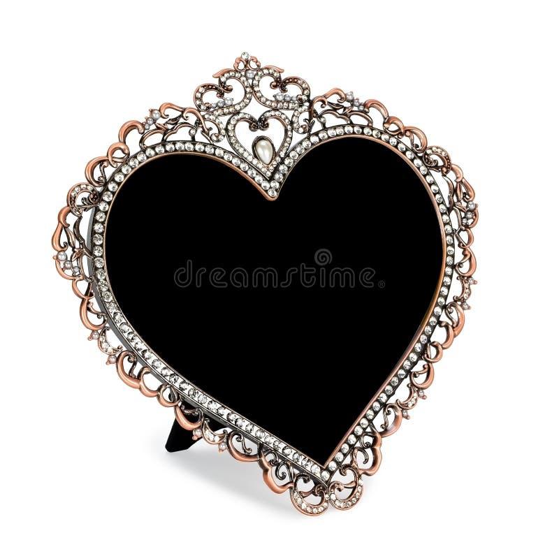 Metal le cadre de photo marqueté avec des fausses pierres sous la forme de coeur image stock