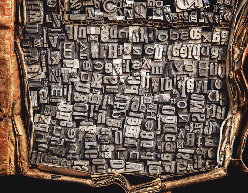 Metal letters in a cardboard box. Close up stock photos