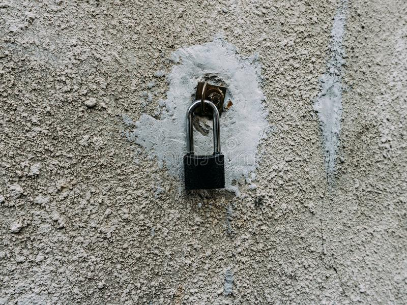 Metal lock on the wall stock image