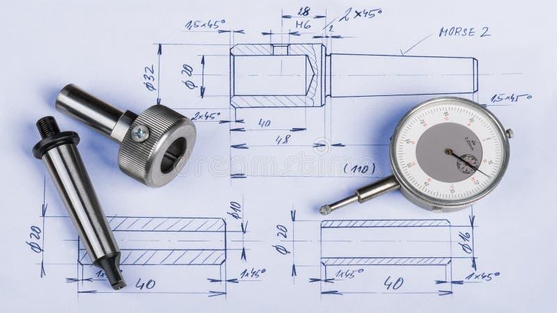 Metal los componentes de la ingeniería, el indicador y el dibujo técnico foto de archivo