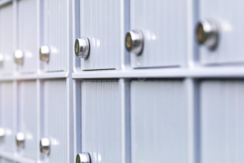 Metal mailboxes and lock in business center of an urban neighbor royalty free stock images