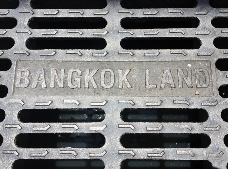 The metal manhole cover at the Bangkok, Thailand. Bangkok land. The metal manhole cover at the Bangkok, Thailand. Bangkok land, There are channels that can look royalty free stock photography