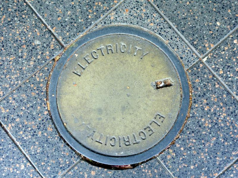 Metal Manhole Cover, Electricity Supply royalty free stock photography